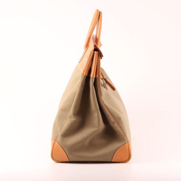 Imagen del lado 1 de la bolsa de viaje hermès haut à courroies lona militar verde piel natural