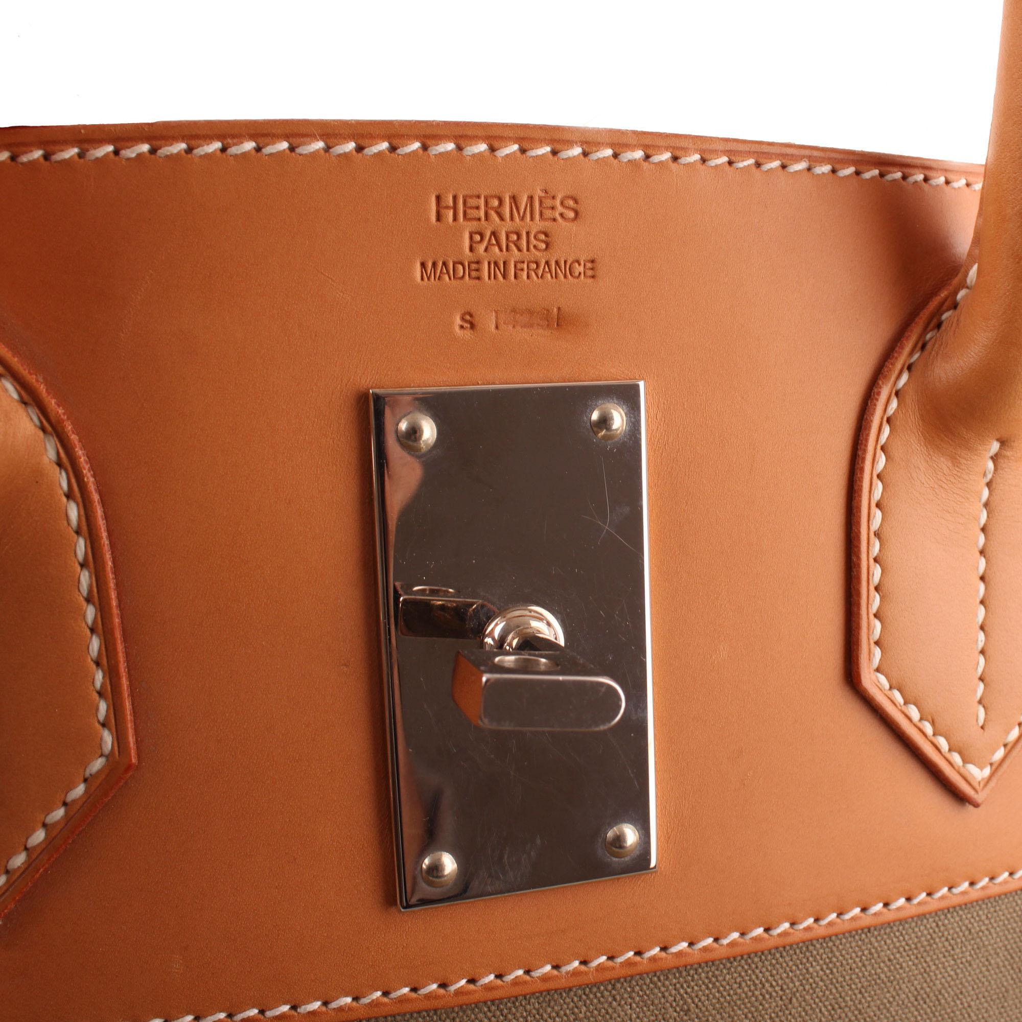 a46410eeec8 ... bolsa de viaje hermès haut à courroies lona militar verde. Imagen de la  marca de la