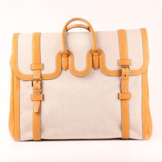 Imagen frontal de la bolsa de viaje maleta hermès bagage drag lona H cuero clémence