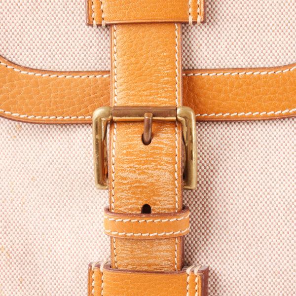 Imagen de la hebilla de la bolsa de viaje maleta hermès bagage drag lona H cuero clémence