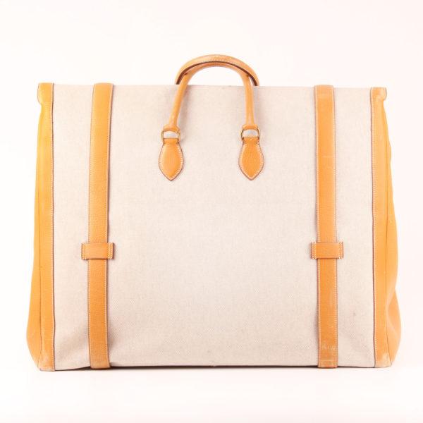 Imagen trasera de la bolsa de viaje maleta hermès bagage drag lona H cuero clémence