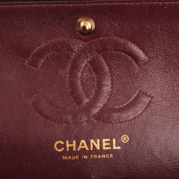 Imagen de la marca del bolso Chanel Timeless Double Flap Bag en piel de cordero.