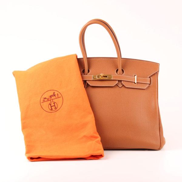 Image fronta del bolso hermes birkin 35 piel tostado con funda guardapolvo