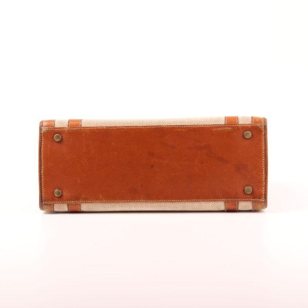 Imagen de la base del bolso hermès drag lona piel natural