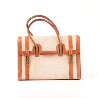Imagen frontal del bolso hermès drag lona piel natural