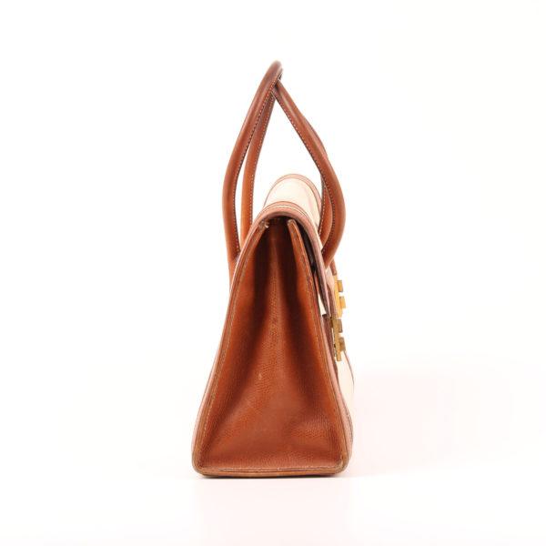 Imagen del lado 1 del bolso hermès drag lona piel natural