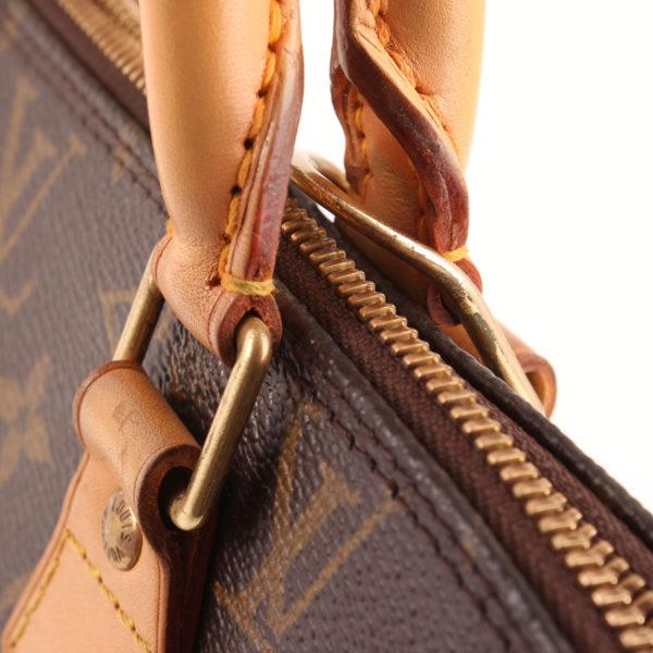 Imagen de la cremallera del bolso louis vuitton alma pm monogram