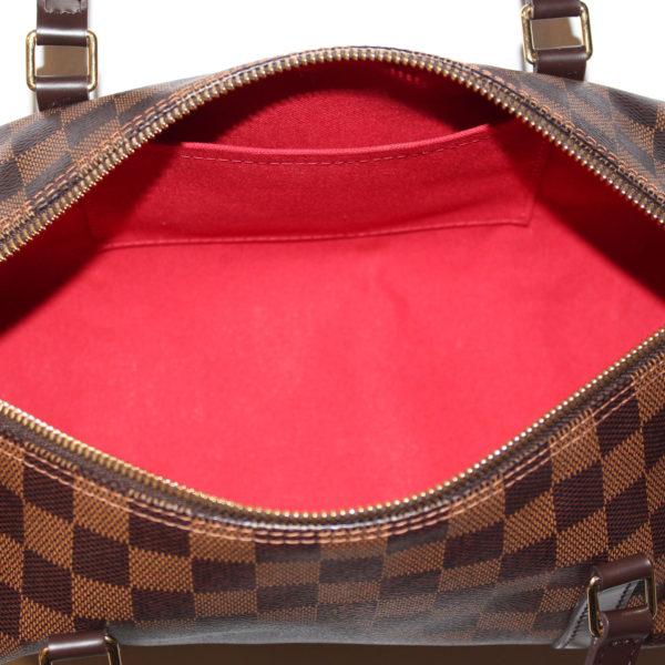 Imagen del forro del bolso louis vuitton papillon damero ébano marrón