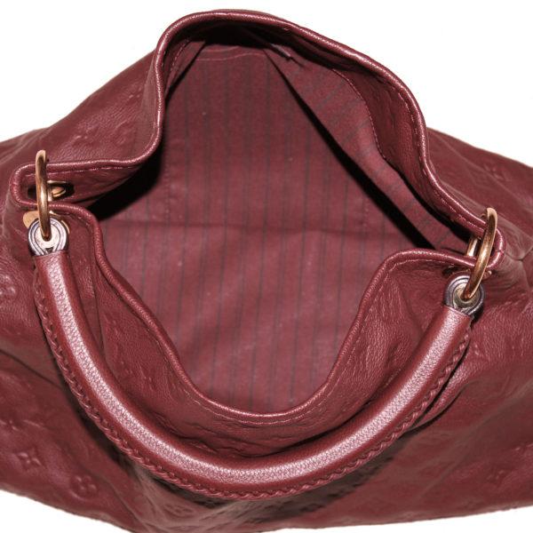 Imagen del interior del bolso tote louis vuitton artsy mm empreinte monogram burdeos
