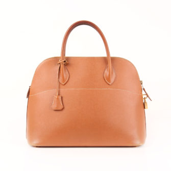 Imagen frontal del bolso hermès bolide courchevel gold