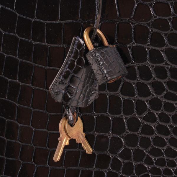imagen de la clochette y el candado del bolso hermès kelly 35 de cocodrilo porosus