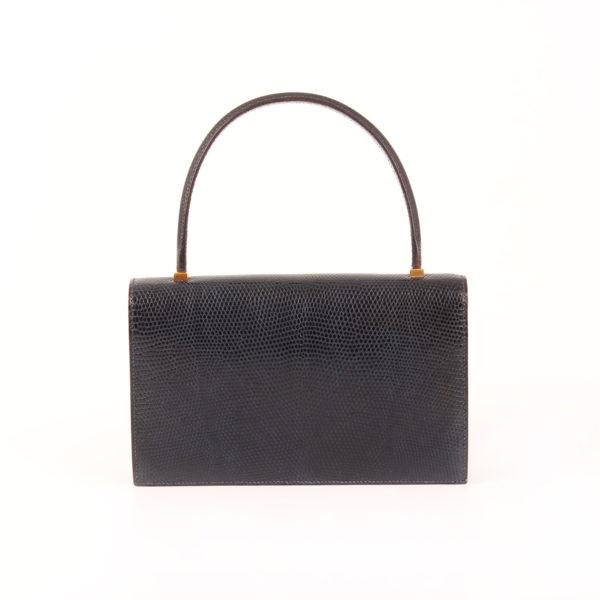 Imagen trasera del bolso hermès piano lagarto azul oscuro