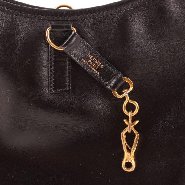 Imagen de la marca del bolso hermès trim II box calf negro