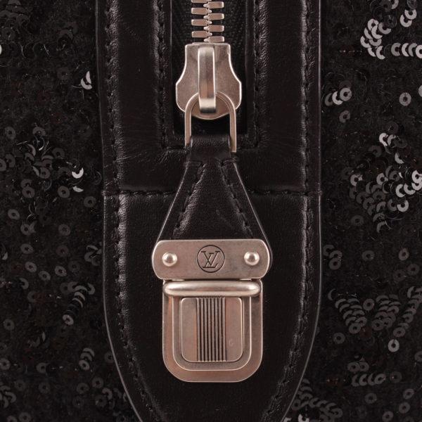 Imagen del cierre de la cremallera del bolso louis vuitton speedy sunshine express monogram lentejuelas