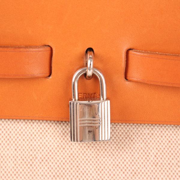 Imagen del candado de la bolsa bolso de viaje hermès herbag lona cruda piel natural