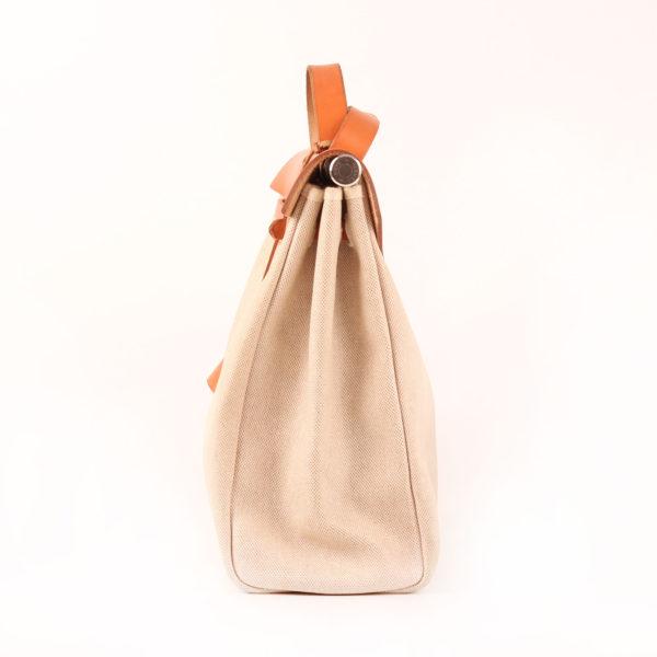 Imagen del lado 1 de la bolsa de viaje convertible hermès herbag lona cruda piel natural