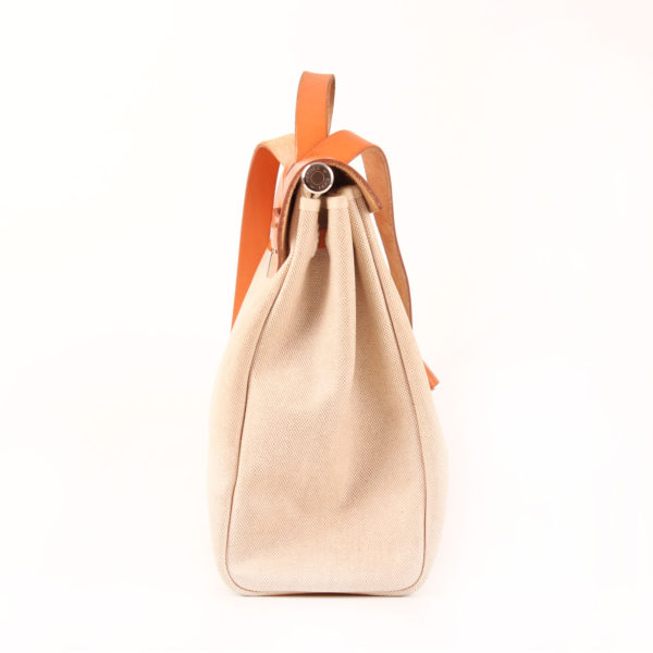 Imagen del lado 2 de la bolsa de viaje convertible hermès herbag lona cruda piel natural