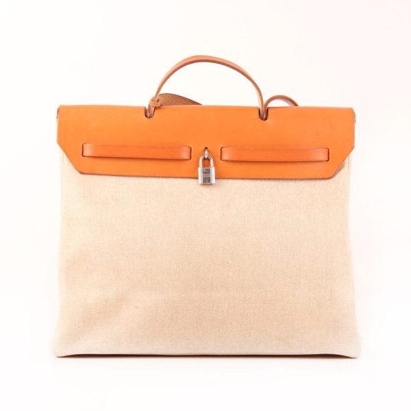 Imagen trasera del bolso bolsa viaje hermès herbag lona cruda piel natural