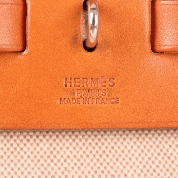 Imagen de la marca del bolso convertible hermès herbag lona cruda piel natural