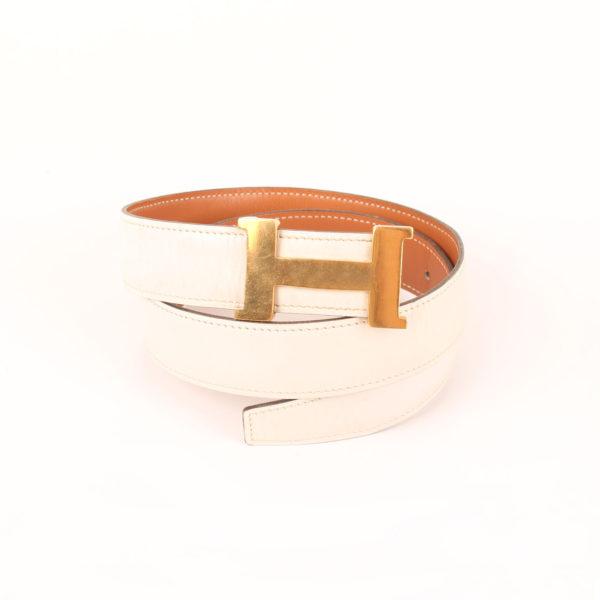 Imagen del cinturón H hermès gold blanco herrajes dorados box calf enrollado