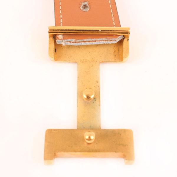 Imagen interior de la hebilla del cinturón H hermès gold blanco herrajes dorados box calf
