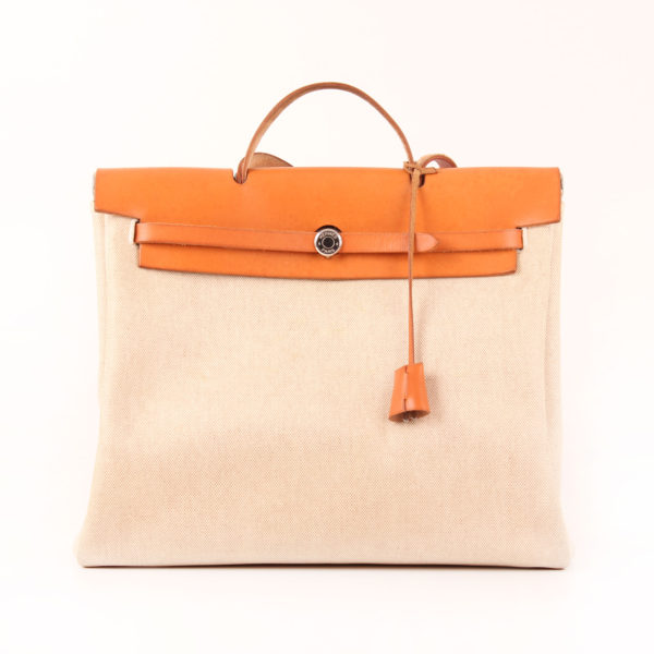 Front image of travel bag hermès herbag ecru canvas natural leather