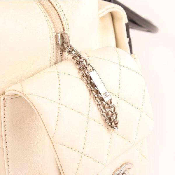 Imagen de la cremallera del bolso chanel cambon reporter blanco