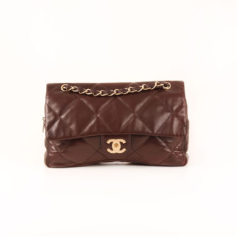 Front image of chanel maxi quilted brown bag