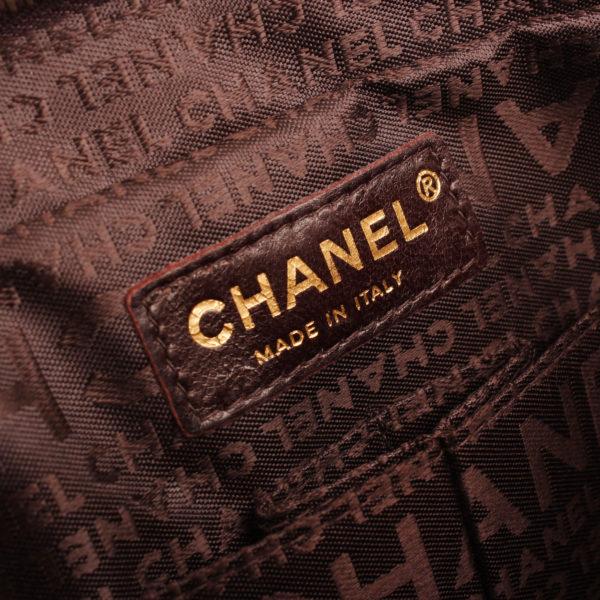 Imagen de la marca del bolso chanel maxi quilted marron