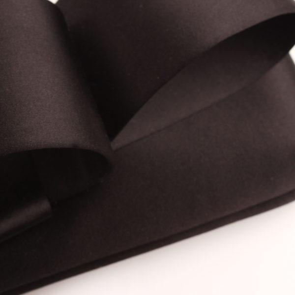 Imagen del tejido del bolso valentino loop clutch