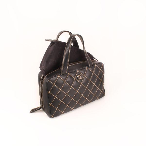 Interior image of chanel wild stitch black tote bag