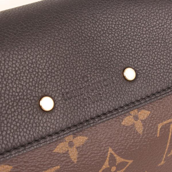 Imagen de la marca del bolso louis vuitton pallas negro monogram
