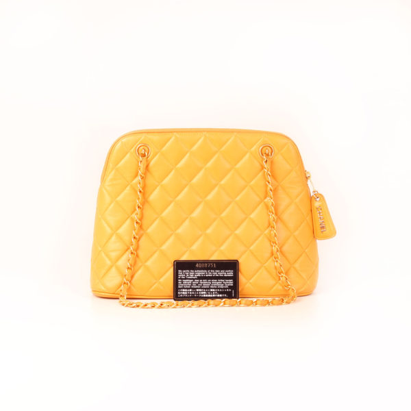 Imagen de la tarjeta del bolso chanel mostaza acolchado