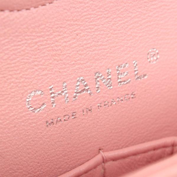 Imagen de la marca del bolso chanel tweed rosa