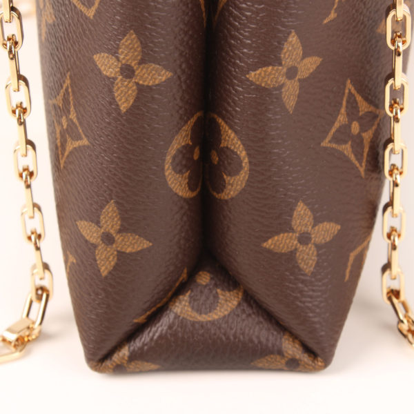 Side detail image of louis vuitton bag pallas black monogram