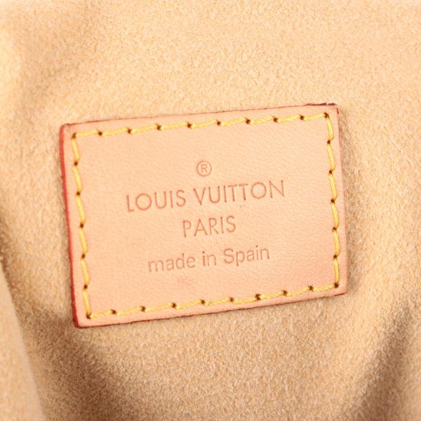 Imagen de la etiqueta del bolso louis vuitton artsy monogram