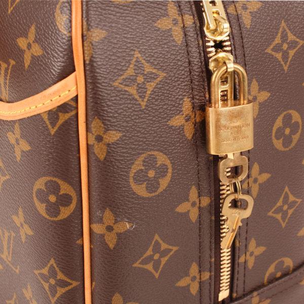 Imagen de los extras del bolso louis vuitton deauville