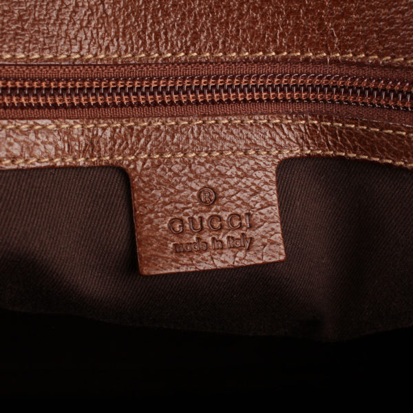 gucci-travel-bag-brand-tag-gg canvas