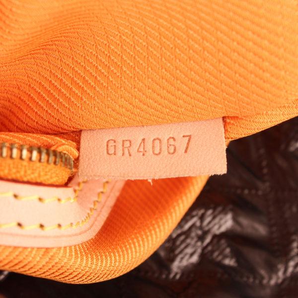 clutch-louis-vuitton-limelight-gm-metallic-black-serial number