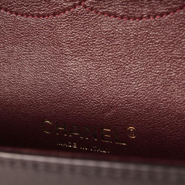 Imagen de la marca del bolso de chanel double flap timeless maxi en piel de cordera negra