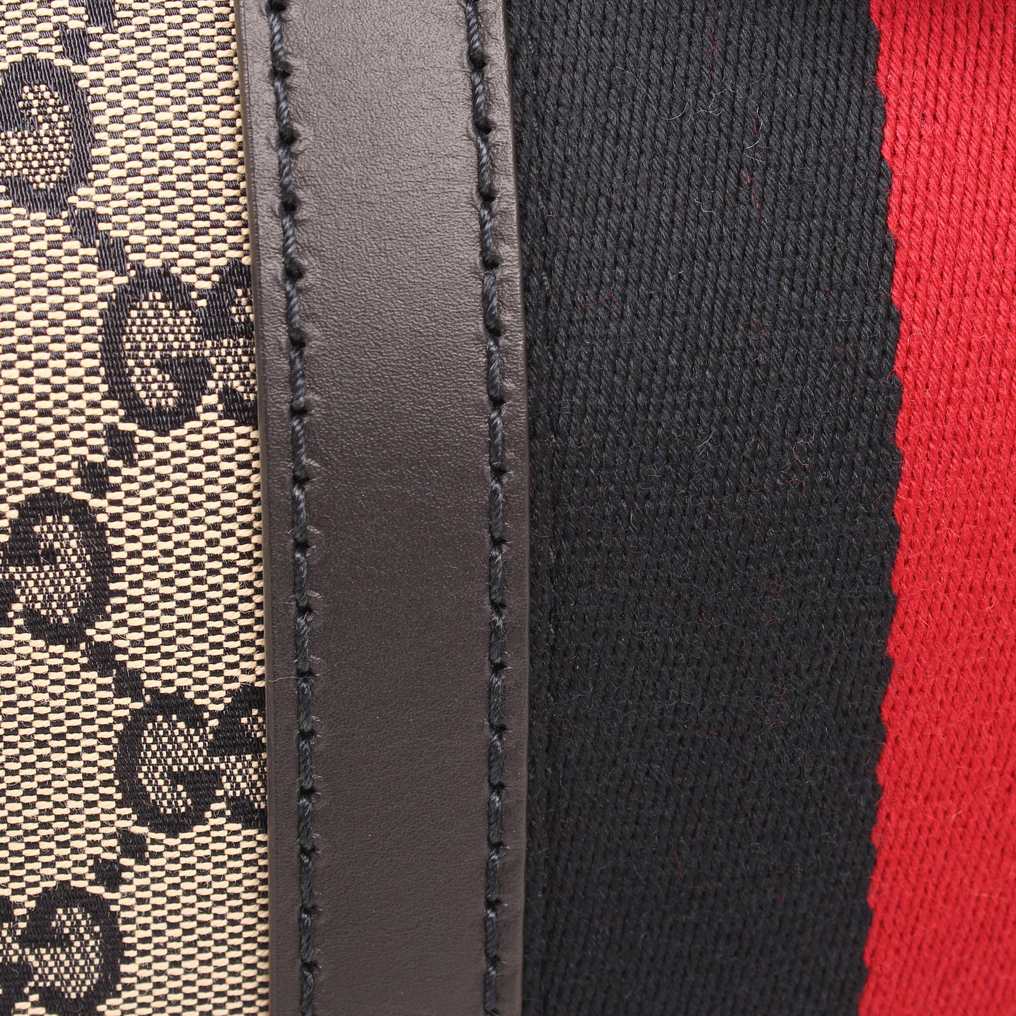 Imagen del tejido del bolso gucci vintage web gg azul