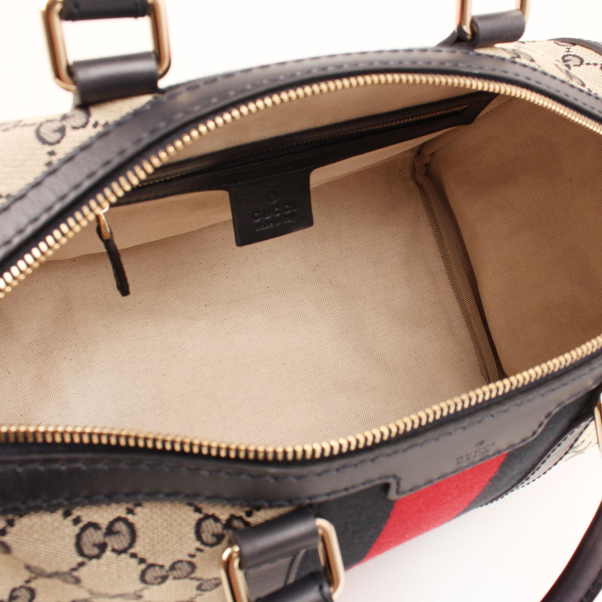 Imagen del interior del bolso gucci vintage web gg azul