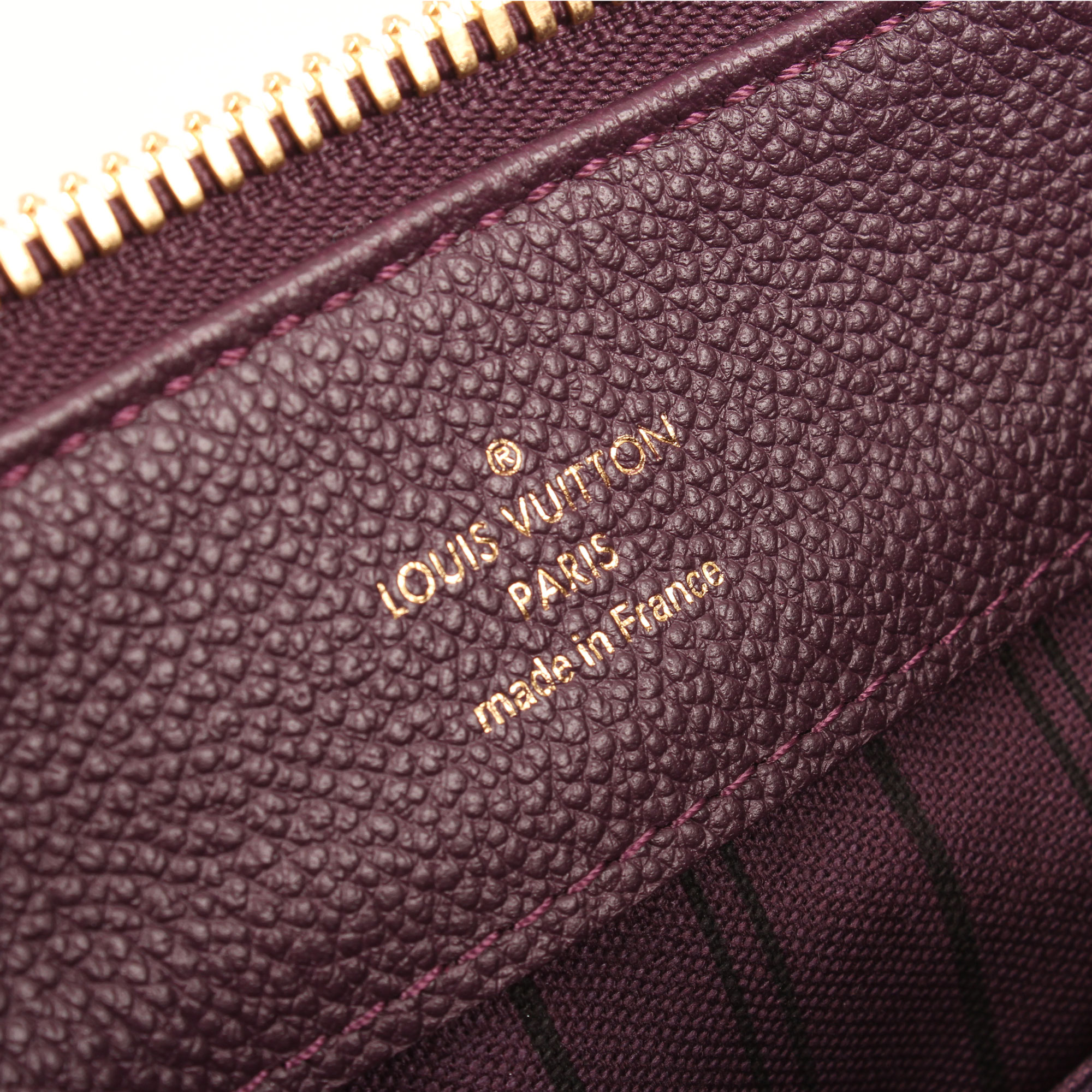 Brand image of louis vuitton audacieuse embossed monogram bag suede plum