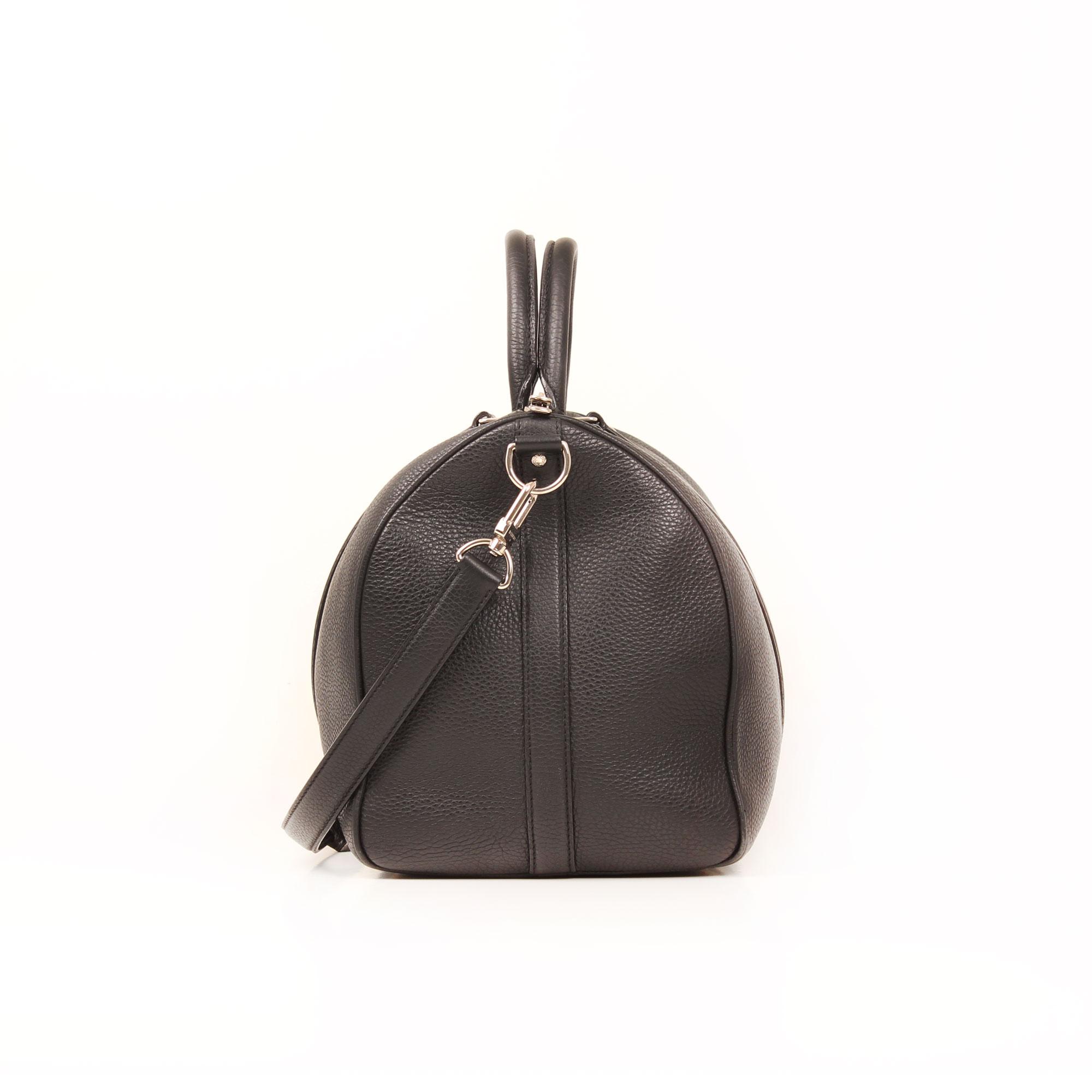 Imagen lateral de la bolsa de viaje louis vuitton keepall 45 piel negro