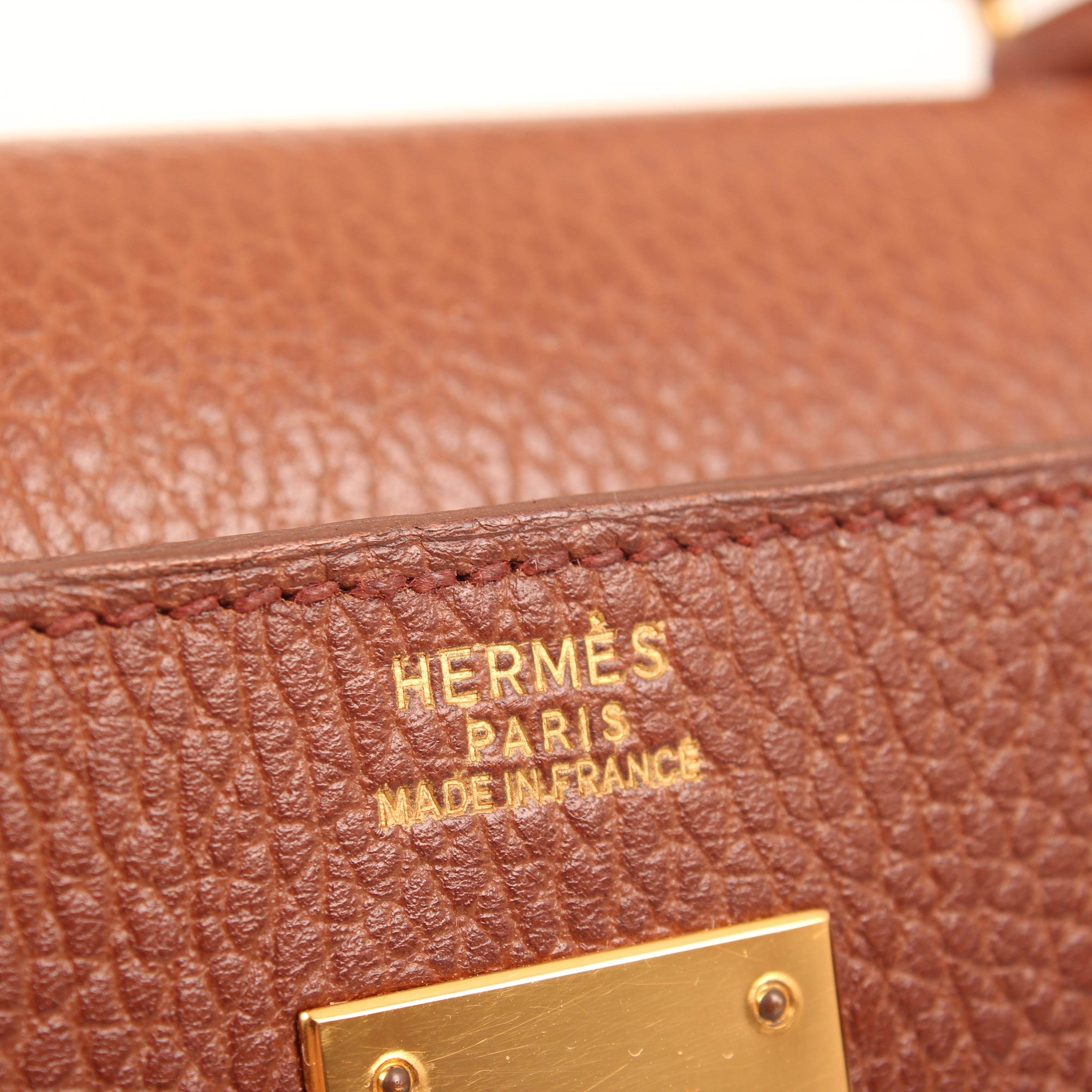 Imagen de la marca del bolso hermes kelly 32 sellier piel ardenas marron noisette