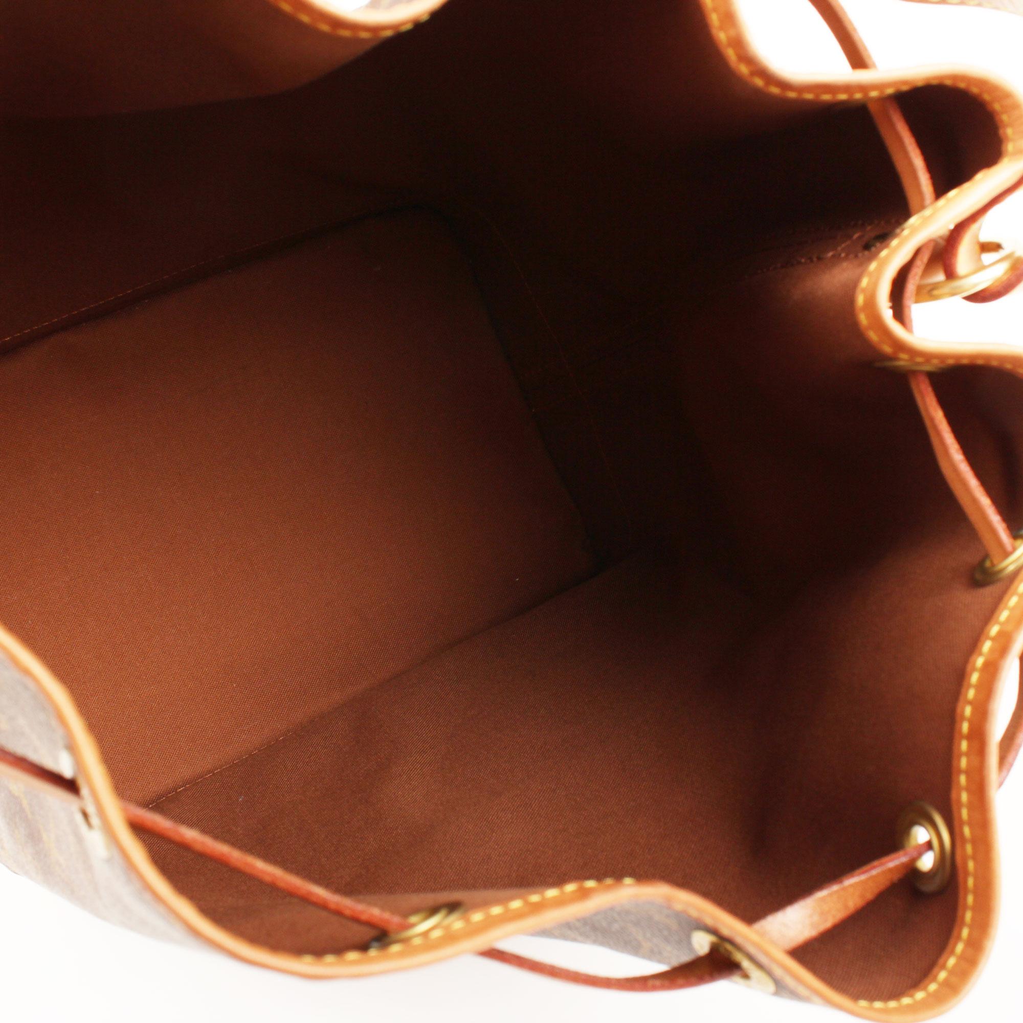 Interior image of louis vuitton noe monogram bag