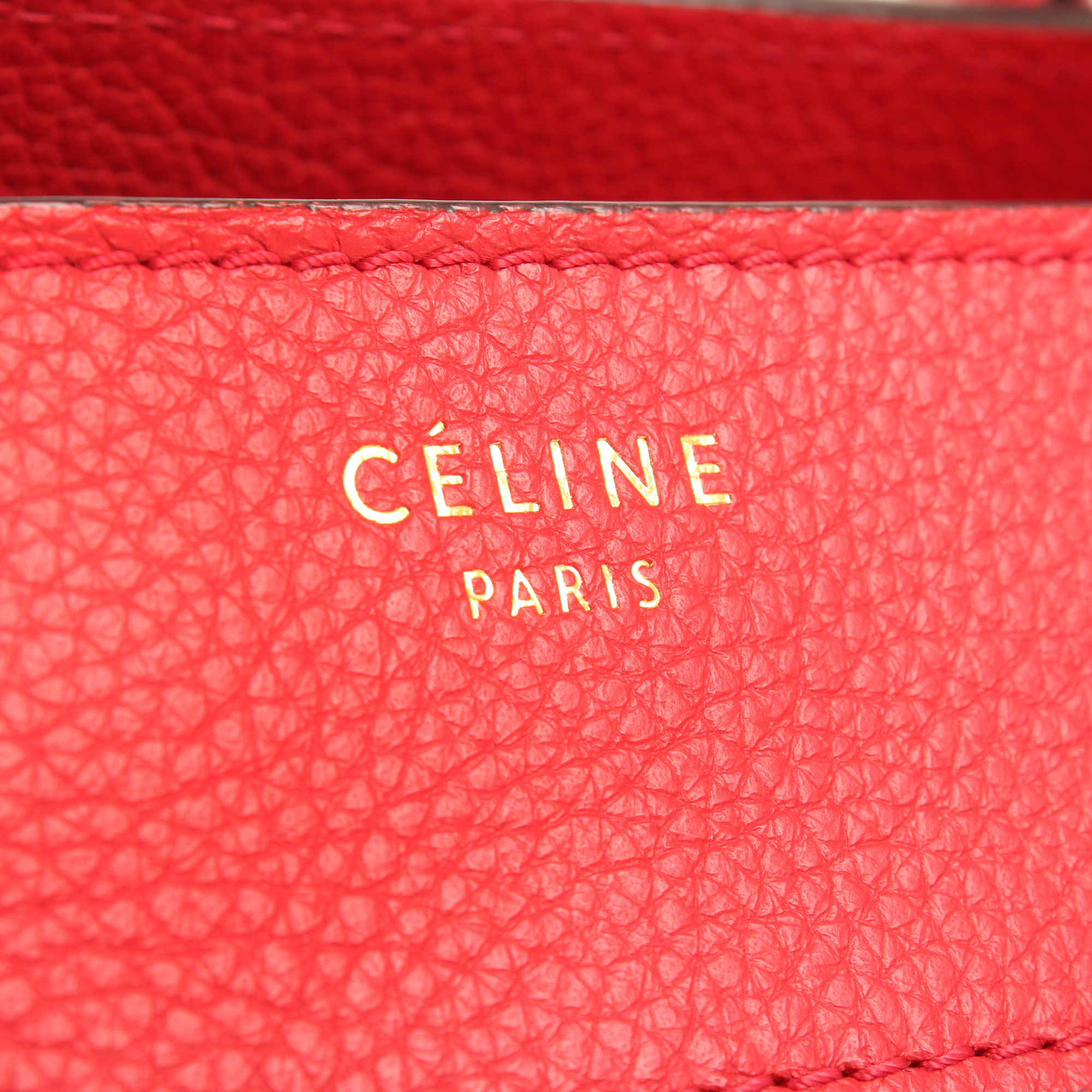 Imagen del logo del bolso celine mini lugagge coquelicot