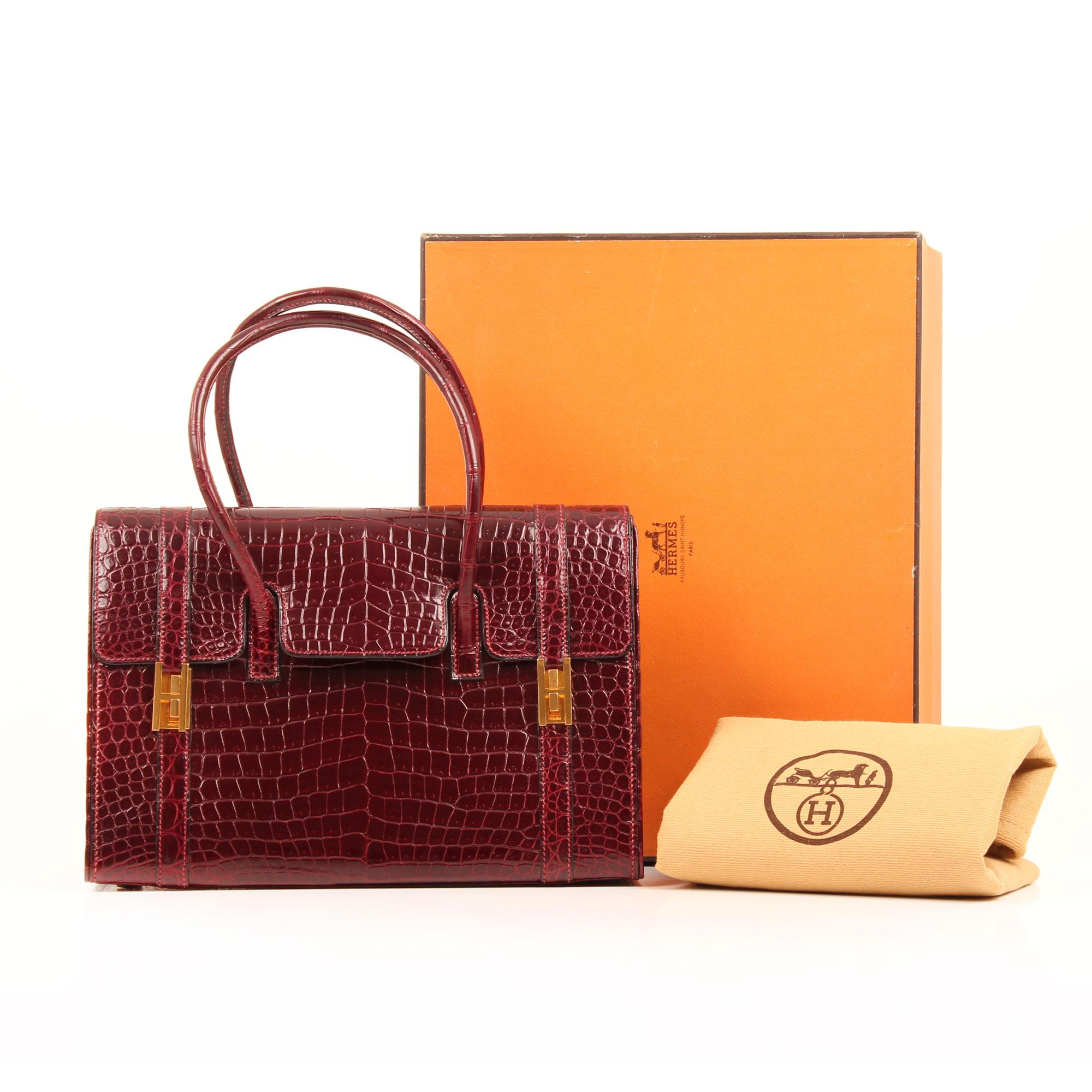 Imagen del dustbag, caja y funda del bolso hermes drag vintage cocodrilo poroso color frambuesa