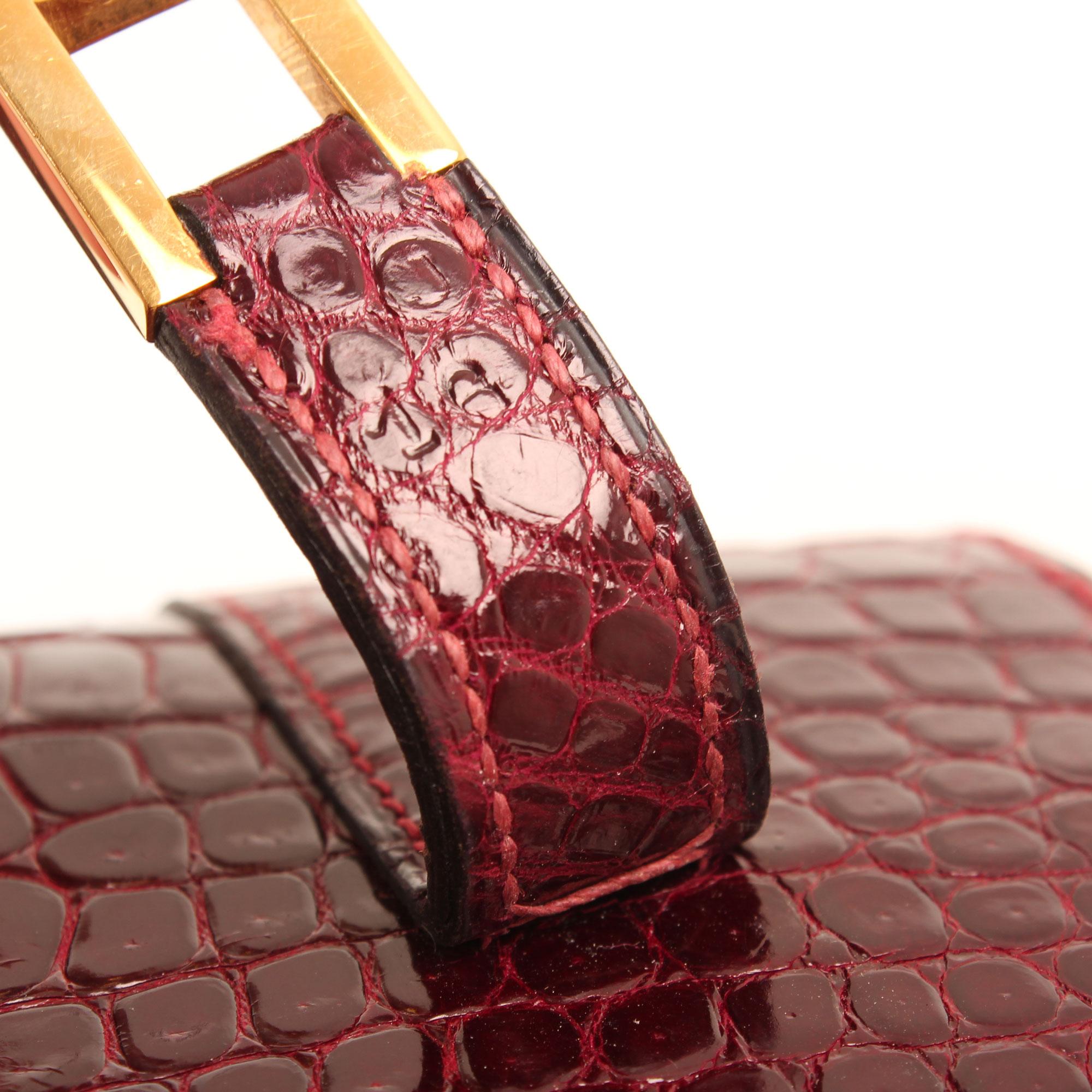 Imagen del serial number del bolso hermes drag vintage cocodrilo poroso color frambuesa