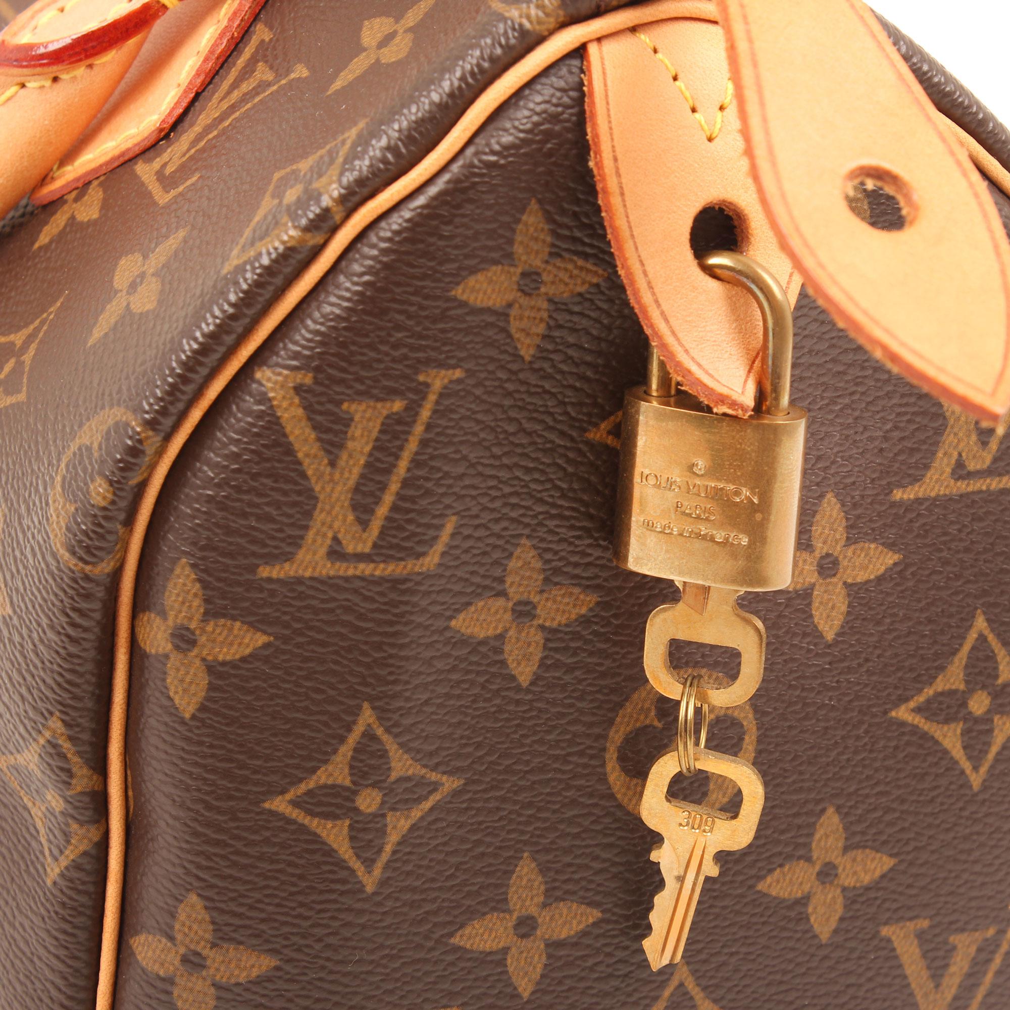 Imagen del candado y llaves del bolso louis vuitton speedy 25 monogram